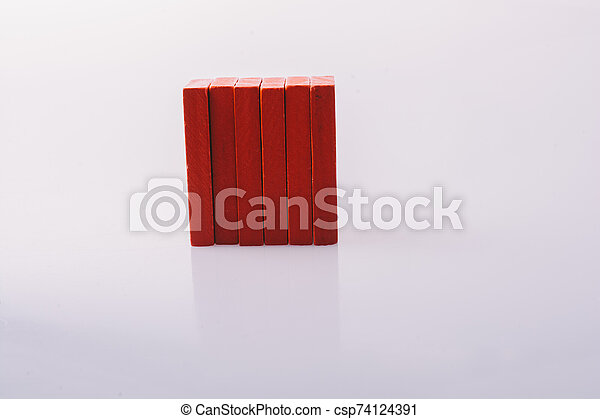 Red color domino blocks on white background - csp74124391