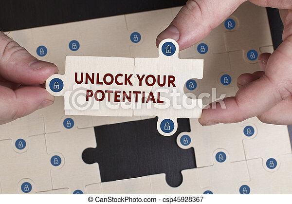"""Negocios, tecnología, Internet y el concepto de red. Un joven hombre de negocios muestra la palabra """"desbloquea tu potencial - csp45928367"""