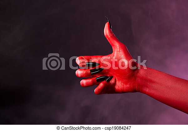 red devil hand showing thumbs up red devil hand with black nails