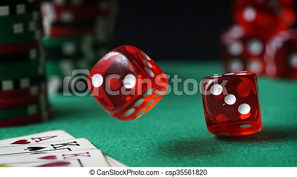 Red dice, casino chips, cards on green felt - csp35561820
