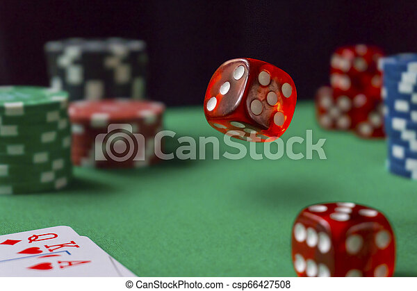 Red dice, casino chips, cards on green felt - csp66427508