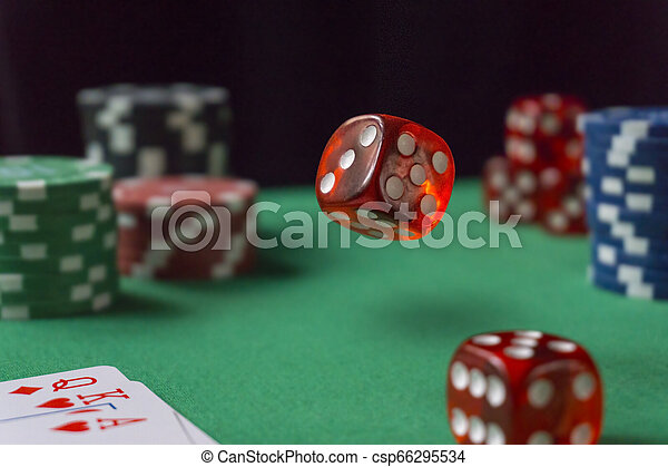 Red dice, casino chips, cards on green felt - csp66295534