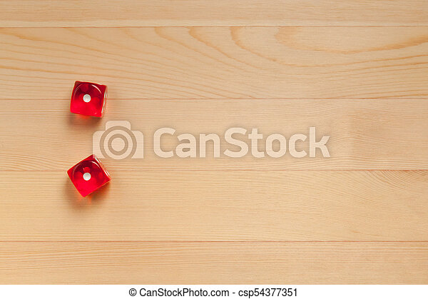 Red dice on a light brown wooden background. Discarded 2 (1 and 1) - csp54377351