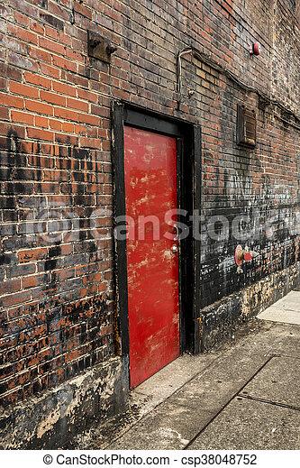 Red Door In Old Brick Wall 2 - csp38048752