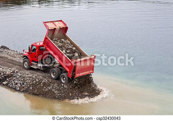 Red Dump Truck Unloading Earth Fill