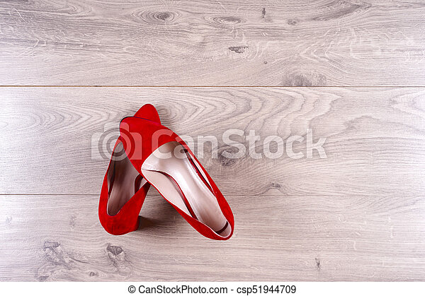 Fashion. Red female shoes on high heels on wooden background. Top view. Copy space for text.. Minimal fashion concept
