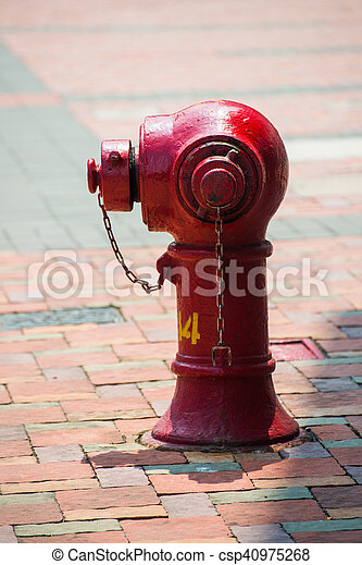 red fire hydrant beside the road in town, safety