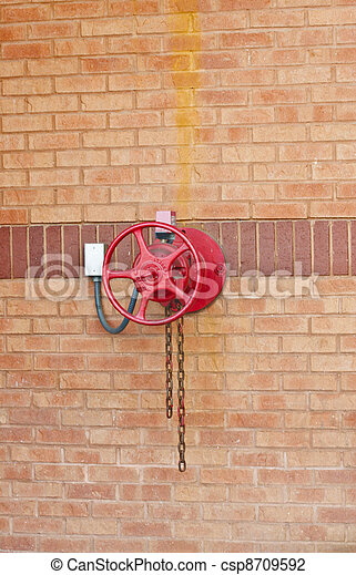 Red Fire Valve on Brick Wall - csp8709592