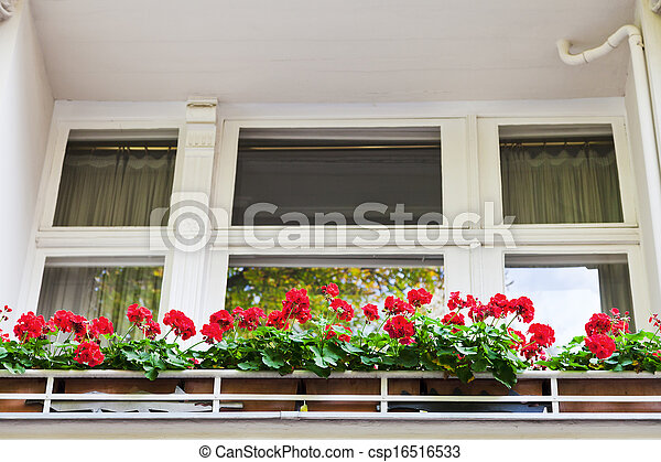 red flowers on balcony of building in Berlin - csp16516533
