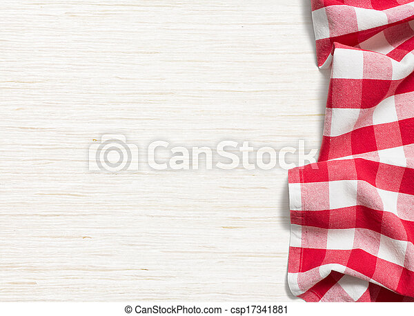 red folded tablecloth over bleached wooden table - csp17341881