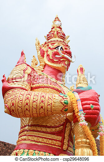 red giant statue standing on white sky background - csp29648096