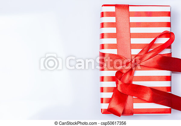 Red gift box with ribbon - csp50617356
