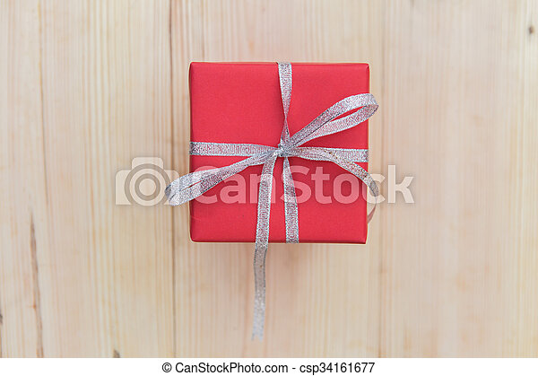 Red giftbox on wooden - csp34161677