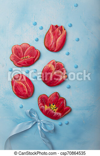 red gingerbread in the form of flowers on a blue background - csp70864535