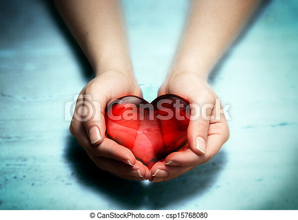 Red glass heart in woman hands - csp15768080