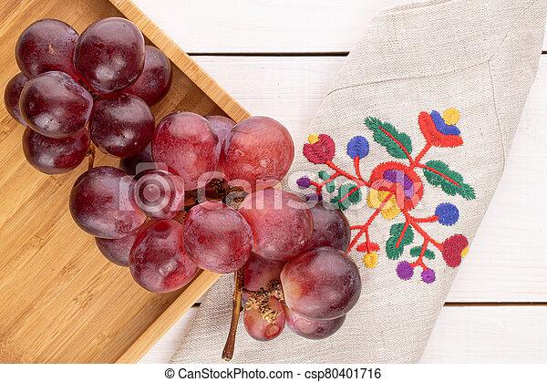 Red globe grape on white wood - csp80401716