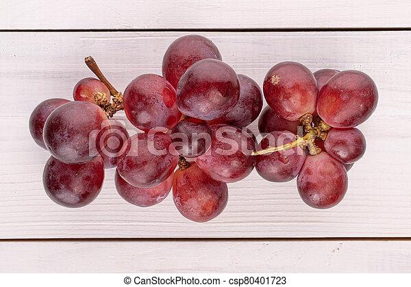 Red globe grape on white wood - csp80401723