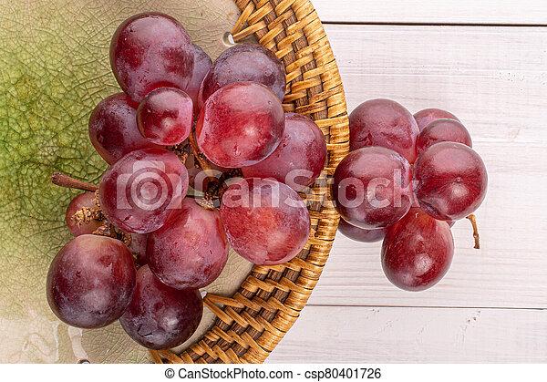 Red globe grape on white wood - csp80401726
