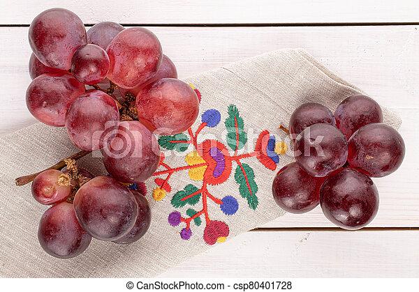 Red globe grape on white wood - csp80401728
