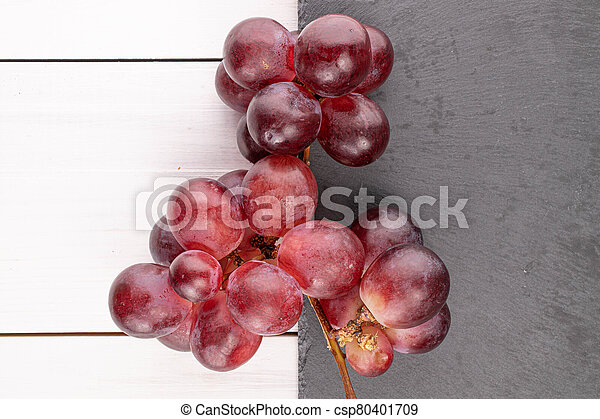 Red globe grape on white wood - csp80401709