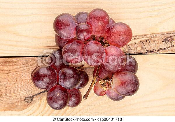Red globe grape on wood - csp80401718