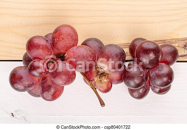 Red globe grape on wood - csp80401722