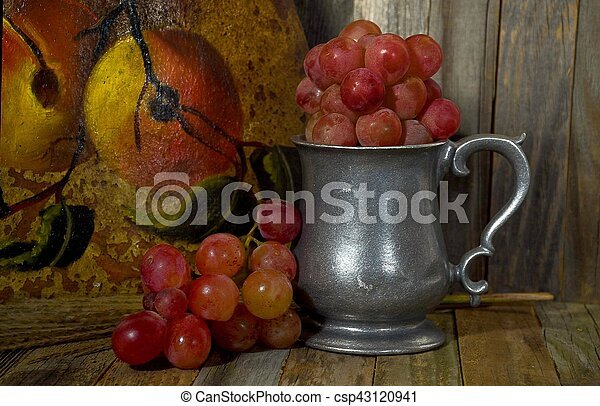 red grapes in pewter pitcher - csp43120941