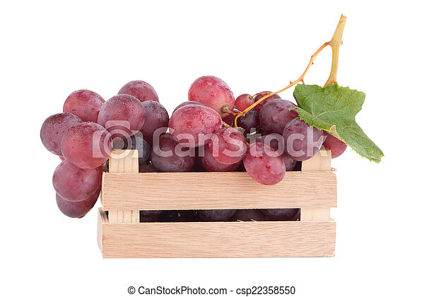 Red grapes in wooden crate - csp22358550