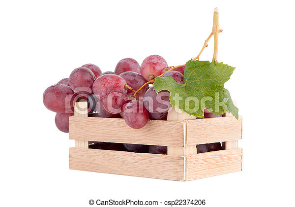 Red grapes in wooden crate - csp22374206