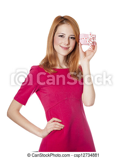 Red-haired woman in dress with present box at white background. - csp12734881