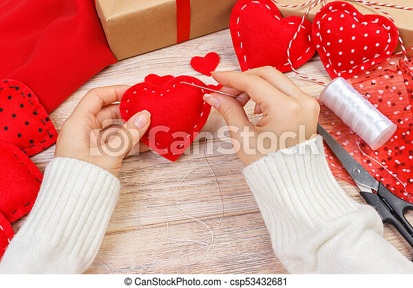 Red handmade heart-shaped soft toy, Valentine day, romantic relationship, healthy lifestyle, beautiful present, love and health care concept. holiday decorate valentine day - csp53432681