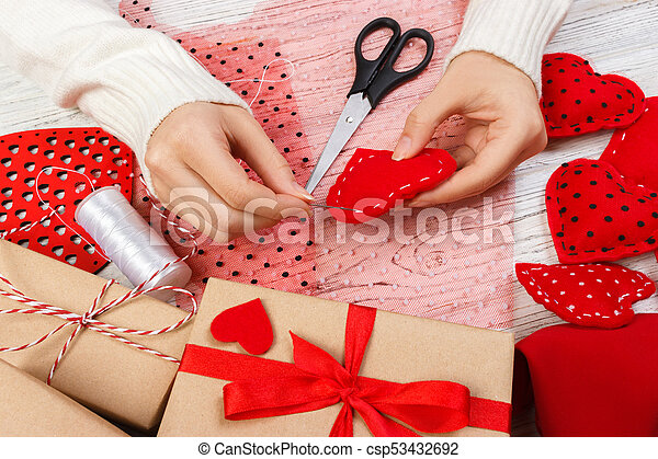 Red handmade heart-shaped soft toy, Valentine day, romantic relationship, healthy lifestyle, beautiful present, love and health care concept. holiday decorate valentine day - csp53432692