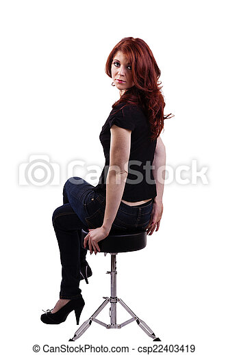 Red Headed Caucasian Woman Sitting On Stool - csp22403419