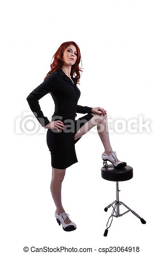 Red Headed Woman In Business Outfit Stool - csp23064918