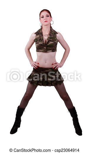 Red Headed Woman In Camouflage Outfit Standing - csp23064914