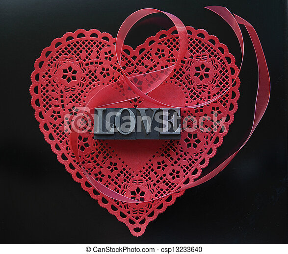 red heart doily with love on black - csp13233640