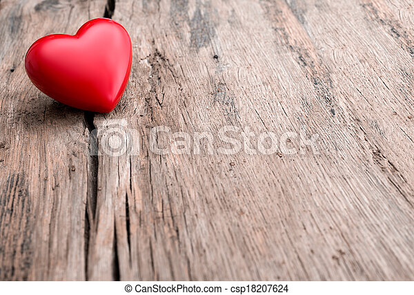 Red heart in crack of wooden plank - csp18207624