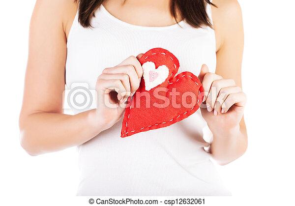 Red heart in hands - csp12632061