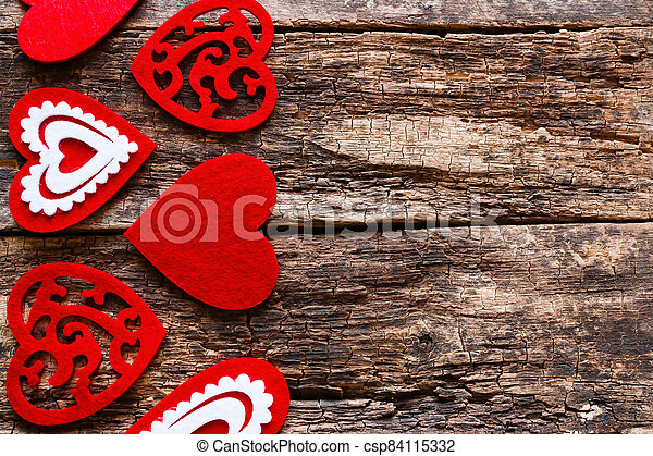 red heart on a wooden background - csp84115332