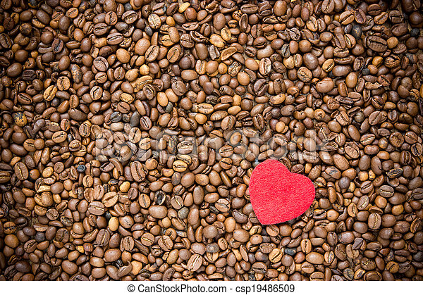 Red heart on coffee beans background - csp19486509