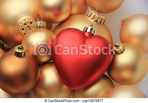 red heart shaped christmas ornament a red heart shaped ornament on
