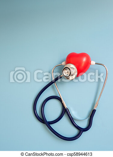 red heart using deep blue stethoscope on the blue background for hear their own heart. Concept of love and caring patient by the heart. Copy space for the text and contents - csp58944613