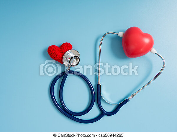 red heart using deep blue stethoscope on the blue background for hear their other heart. Concept of love and caring patient by the heart. Copy space for the text and contents - csp58944265