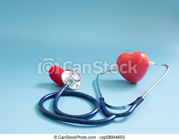 red heart using deep blue stethoscope on the blue background for hear their other heart. Concept of love and caring patient by the heart. Copy space for the text and contents - csp58944653