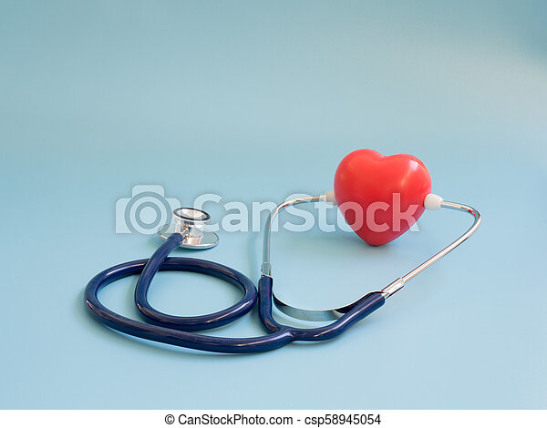 red heart using deep blue stethoscope on the blue background. Concept of love and caring patient by the heart. Copy space for the text and contents - csp58945054