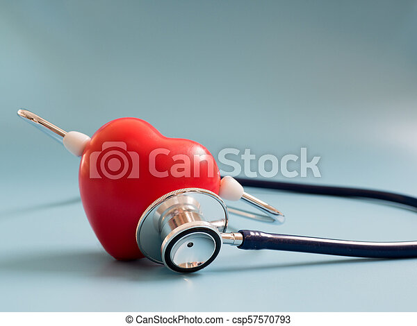 red heart using deep blue stethoscope on the blue background for hear their own heart. Concept of love and caring patient by the heart. Copy space for the text and contents - csp57570793