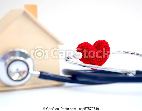 red heart using stethoscope on the blue background for house health check. Concept of love and caring patient house by the heart. Copy space for the text and contents - csp57570749