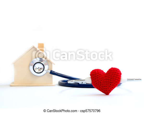 red heart using stethoscope on the blue background for house health check. Concept of love and caring patient house by the heart. Copy space for the text and contents - csp57570796