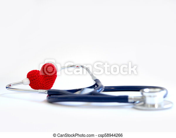 red heart using stethoscope on the white background (Isolated background). Concept of love and caring patient by the heart. Copy space for the text and contents - csp58944266
