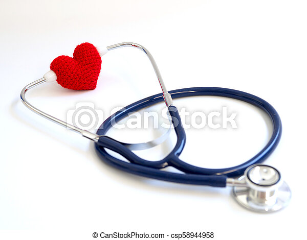 red heart using stethoscope on the white background (Isolated background). Concept of love and caring patient by the heart. Copy space for the text and contents - csp58944958